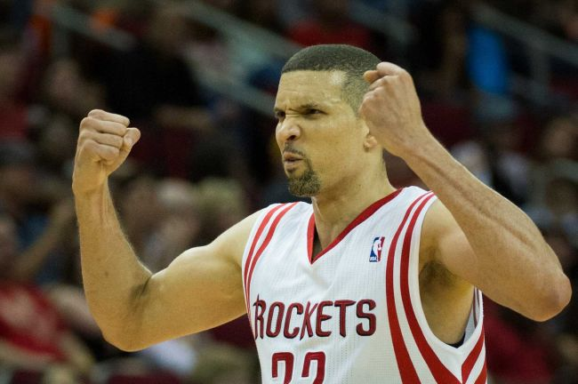 Houston Rockets shooting guard Francisco Garcia flexes his muscles in celebration during the second half of an NBA basketball game at Toyota Center on Saturday, March 30, 2013, in Houston. The Rockets won the game 98-81. Garcia scored 15 points in the game. ( Smiley N. Pool / Houston Chronicle )