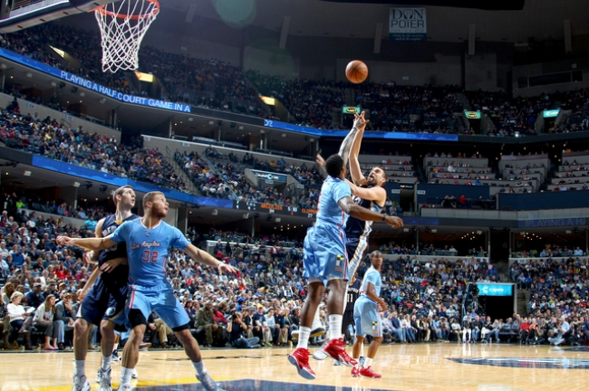 November 23, 2014 -  Memphis Grizzlies Marc Gasol, right, shoots and is fouled by Los Angeles Clippers DeAndre Jordan at FedExForum. (Nikki Boertman/The Commercial Appeal)