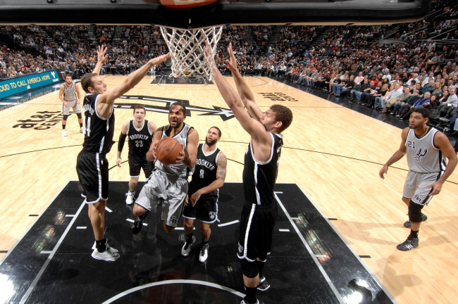 SAN ANTONIO, TX - NOVEMBER 22:  Tony Parker #9 of the San Antonio Spurs goes up for a shot against the Brooklyn Nets at the AT&T Center on November 22, 2014 in San Antonio, Texas. NOTE TO USER: User expressly acknowledges and agrees that, by downloading and or using this photograph, user is consenting to the terms and conditions of the Getty Images License Agreement. Mandatory Copyright Notice: Copyright 2014 NBAE (Photos by D. Clarke Evans/NBAE via Getty Images)