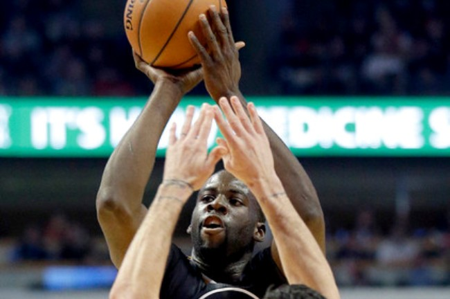 """Golden State Warriors forward Draymond Green (23) shoots over Chicago Bulls guard Kirk Hinrich (12) during the first half of an NBA basketball game in Chicago on Saturday, Dec. 6, 2014. (AP Photo/Nam Y. Huh)"""